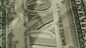 Macro elements on the US one dollar bill. US dollars background. Rotating macro elements on the US one dollar battered bill. US dollars background stock video footage