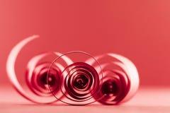 Macro, extracto, imagen del fondo de espirales de papel rojos Foto de archivo libre de regalías