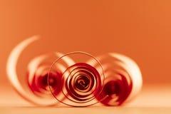 Macro, extracto, imagen del fondo de espirales de papel rojos Fotos de archivo