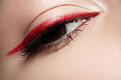 Macro eye with fashion bright eyeliner make-up Royalty Free Stock Photography