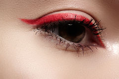 Macro eye with fashion bright red eyeliner make-up Stock Photos