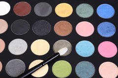 Macro eye shadow palette makeup with brush Stock Photos