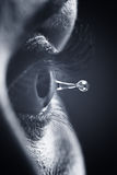 Macro on eye with tears water droplet Royalty Free Stock Photography