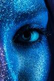 Macro eye of woman in blue bodyart Royalty Free Stock Photography