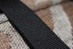 Macro fabric. Couch and straps royalty free stock photo