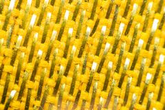 Macro of fabric weave texture surface. Yellow or orange color use for background Stock Image