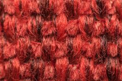 Macro of fabric weave texture surface. Red or pale orange color use for background Stock Photos
