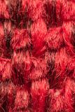 Macro of fabric weave texture surface. Red or pale orange color use for background Stock Images