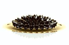 Macro of Ferrofluid on white surface Royalty Free Stock Photography