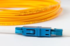 Macro Fiber optic patchcord  on white background Royalty Free Stock Photography