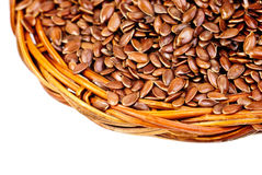 Macro flax seeds isolated on white Royalty Free Stock Photo