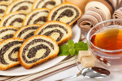 Macro of poppy seed rolls and tea Royalty Free Stock Images