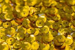 Macro fondo degli zecchini dorati fotografie stock libere da diritti