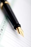 Macro of a fountain pen on a day planner Royalty Free Stock Photo