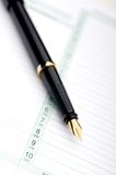 Macro of a fountain pen on a day planner. Macro of a fountain pen on a business day planner Royalty Free Stock Photo
