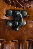 Macro fragment of a leather bag or purse. Handmade, texture background. Fastened buckle. Buckle section of a leather Brown bag or case. purses . Macro fragment Stock Photo
