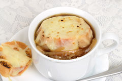 Macro french onion soup with cheese bread Royalty Free Stock Images