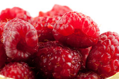 Raspberries. Natural fresh raspberries in wicker basket against  white background Royalty Free Stock Photography