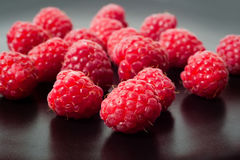 Macro of fresh raspberry on black. Textured background Stock Images