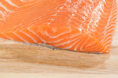Fresh raw salmon on wood. Macro of fresh raw salmon on wood Stock Photo