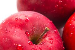Macro of fresh red wet apples with drops. Macro of fresh red wet apples with water drops. Healthy eating royalty free stock photos