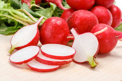 Macro of fresh sliced radish in crate Royalty Free Stock Image