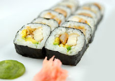 Macro of fried breaded chicken sushi rolls with wasabi and pickled ginger Royalty Free Stock Photos