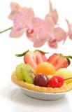 Macro Fruit tart. Fruit tart and Beautiful wild orchids Royalty Free Stock Photography
