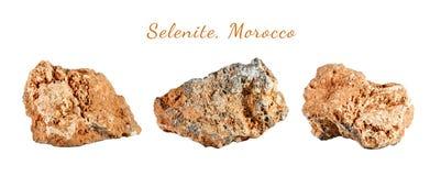Macro fucilazione della pietra preziosa naturale Selenite minerale cruda, Marocco Oggetto isolato su una priorità bassa bianca Fotografie Stock