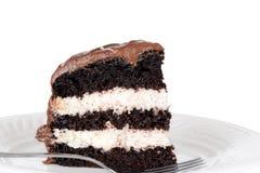 Macro gâteau de crème de chocolat avec la fourchette Image libre de droits
