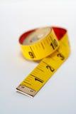 Macro gialla di misura di nastro Fotografia Stock