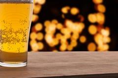 Macro glass of beer on light bokeh Royalty Free Stock Photos
