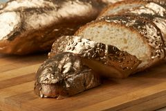 Macro of golden baguette bread royalty free stock images