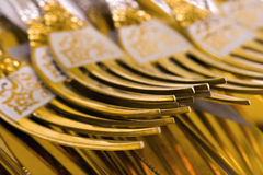 Macro of golden forks Royalty Free Stock Images