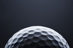 Macro golf ball on dark blue  background, space for text. Stock Photography