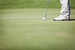 Macro of golf player putting. Stock Image