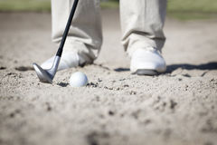 Macro of golfer in bunker. Stock Photo