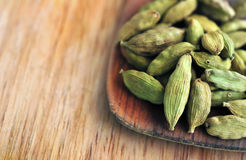 Macro Green cardamom with spatula on the wooden desk Stock Image