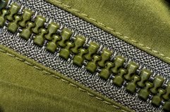 Macro of green plastic zipper. Macro of green plastic nylon zipper Royalty Free Stock Image