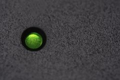 Macro green power LED on black plastic with copyspace. Macro green power LED on black plastic with copy space royalty free stock photo