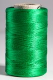 Macro green spool of thread Royalty Free Stock Photography