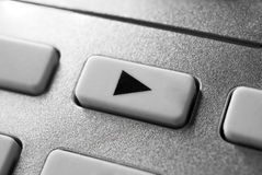 Macro Of A Grey Play Button On Chrome Remote Control For A Hifi Stereo Audio System Stock Image