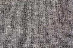 Macro grigia dell'abbigliamento del tessuto fotografia stock