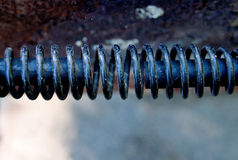 Macro of grill handle. Macro of spring-like barbecue grill handle Stock Photography