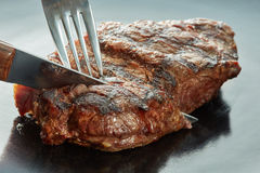 Macro of grilled meat on dark Stock Images