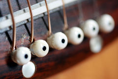 Macro guitar pins. Macro image of pins on an acoustic guitar royalty free stock image