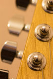 Macro of guitar tuning pegs. And strings Stock Images