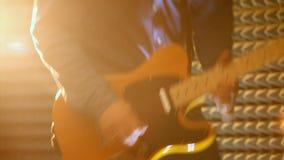 Macro Guy Plays Electric Guitar in studio video d archivio