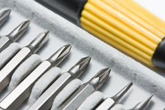 Macro of handle and screwdriver bit Royalty Free Stock Photography