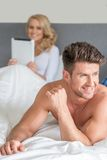 Macro Handsome Couple Partner on Bed Fashion Shoot Stock Images
